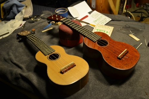 Handmade ukuleles on he workbench.